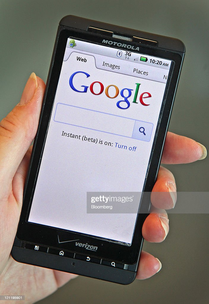The Google Inc. homepage is seen on a Motorola Holdings Inc. mobile device, running on Google's Android software, in Park Ridge, Illinois, U.S., on Monday, Aug. 15, 2011. Google Inc., maker of the Android mobile-phone software, agreed to buy smartphone maker Motorola Mobility Holdings Inc. for $12.5 billion in its biggest deal, gaining mobile patents and expanding in the hardware business. Photographer: Tim Boyle/Bloomberg via Getty Images