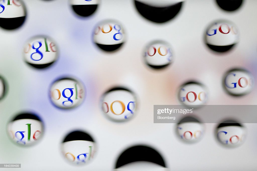 The Google Inc. logo is reflected in water droplets for an arranged photograph in Washington, D.C., U.S., on Monday, Oct. 15, 2012. Google Inc. is scheduled to release earnings data on Oct. 18. Photographer: Andrew Harrer/Bloomberg via Getty Images
