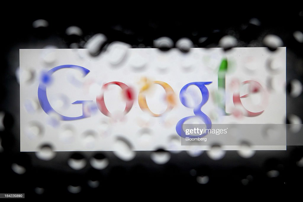 The Google Inc. logo is seen through water droplets for an arranged photograph in Washington, D.C., U.S., on Monday, Oct. 15, 2012. Google Inc. is scheduled to release earnings data on Oct. 18. Photographer: Andrew Harrer/Bloomberg via Getty Images