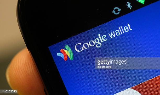 The Google Inc Mobile Wallet application for cardless payment is displayed on a smartphone screen at the Mobile World Congress in Barcelona Spain on...