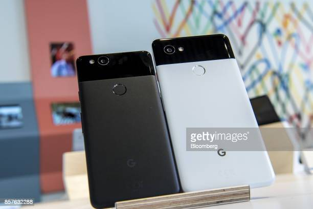 The Google Inc Pixel 2 left and Pixel 2 XL smartphones are displayed during a product launch event in San Francisco California US on Wednesday Oct 4...