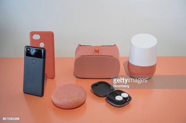 The Google Inc Pixel 2 smartphone from left Home Mini voice speaker Daydream virtual reality headset Pixel Buds headphones and Google Home Max device...