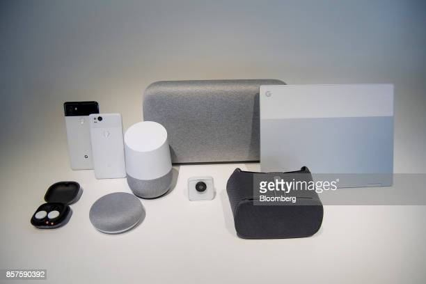 The Google Inc Pixel 2 XL and Pixel 2 smartphones from left Pixel Buds wireless headphones Home Mini voice speaker Google Home Max Google Clips...