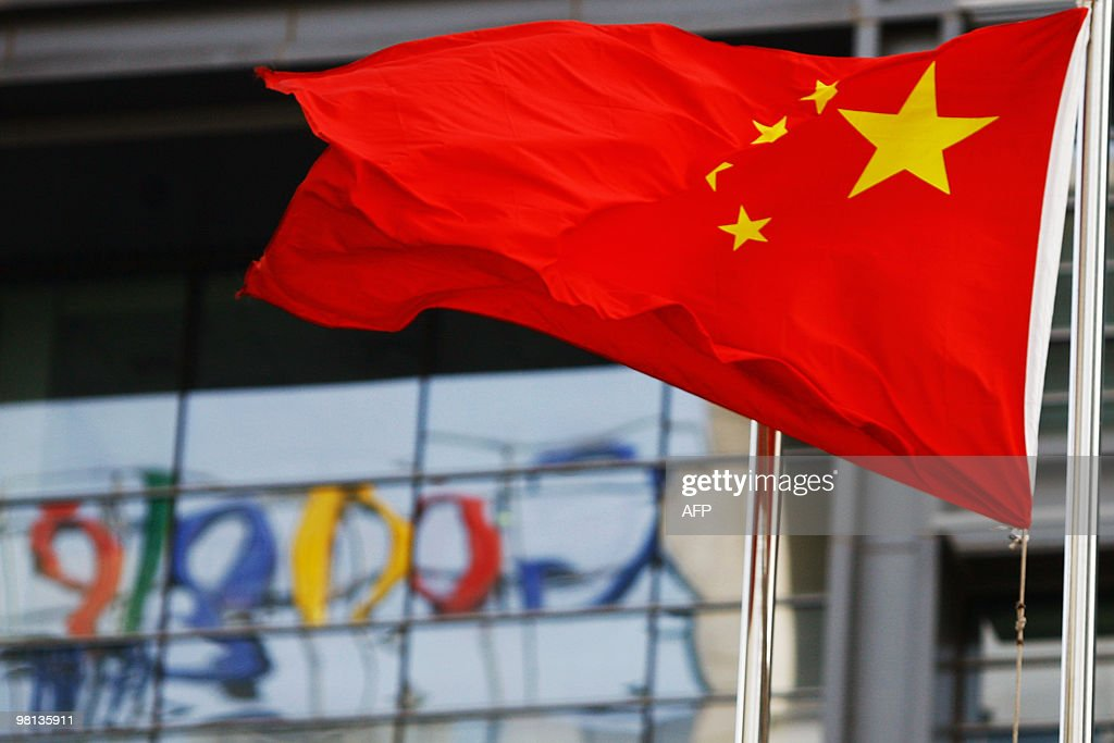 The Google logo is reflected in windows of the company's China head office as the Chinese national flag flies in the wind in Beijing on March 23 2010...