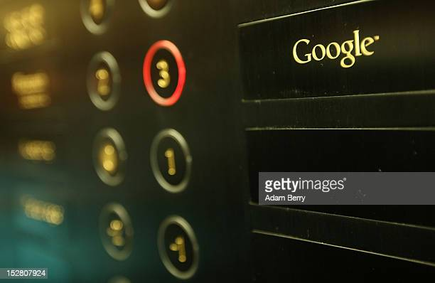 The Google logo is seen next to the button of an elevator on its way up to the official opening party of the company's offices on September 26 2012...