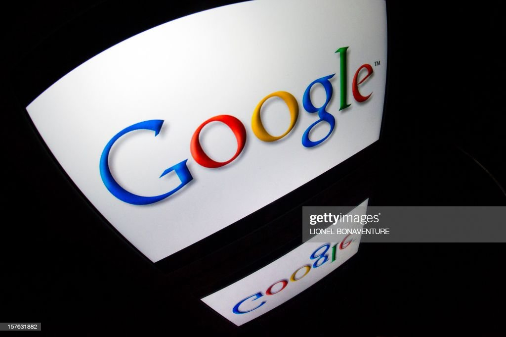 The 'Google' logo is seen on a tablet screen on December 4, 2012 in Paris. AFP PHOTO / LIONEL BONAVENTURE