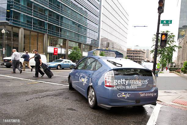 The Google selfdriving car maneuvers through the streets of in Washington DC May 14 2012 The system on a modified Toyota Prius combines information...