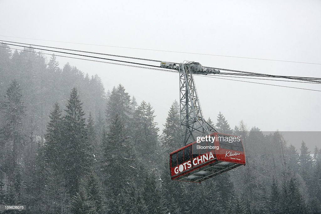 The Gotschna cable car moves down the mountain during a snow storm in Klosters, Switzerland, on Monday, Jan. 21, 2013. This week the business elite gathers in the Swiss Alps for the 43rd annual meeting of the World Economic Forum in Davos, the five day event runs from Jan. 23-27. Photographer: Chris Ratcliffe/Bloomberg via Getty Images