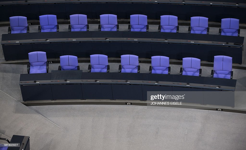 The government's bench with the German Chancellor's seat (front, R) can be seen at the plenary hall of the German Bundestag (lower house of parliament) in Berlin on September 20, 2013. Germans go to the polls on September 22, 2013.