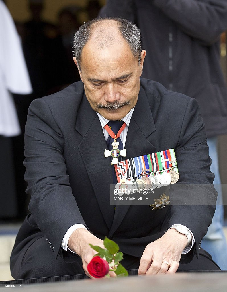 The Governor General of New Zealand Lieutenant General Jerry Mateparae lays a rose on the Tomb of the Unknown Warrior during a ceremony at the National War Memorial in Wellington on June 14, 2012. It is 70 years since the large-scale arrival of US forces in New Zealand in June 1942, following the entry of the US into the Second World War. AFP PHOTO / MARTY MELVILLE