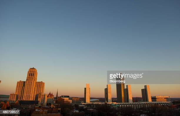 The Governor Nelson A Rockefeller Empire State Plaza right stands in Albany New York US on Wednesday March 19 2014 Budget talks among New York...