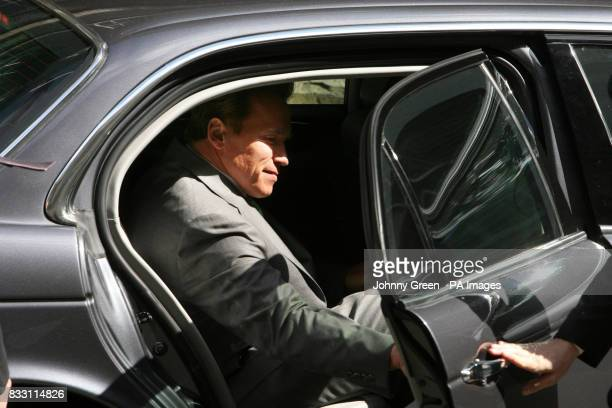 The Governor of California Arnold Schwarzenegger leaves No 10 Downing Street in central London
