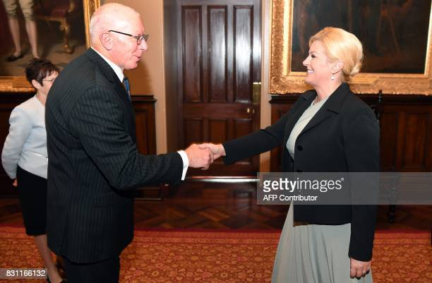 The Governor of New South Wales David Hurley greets Croatia's President Kolinda GrabarKitarovic at Government House in Sydney on August 14 2017...