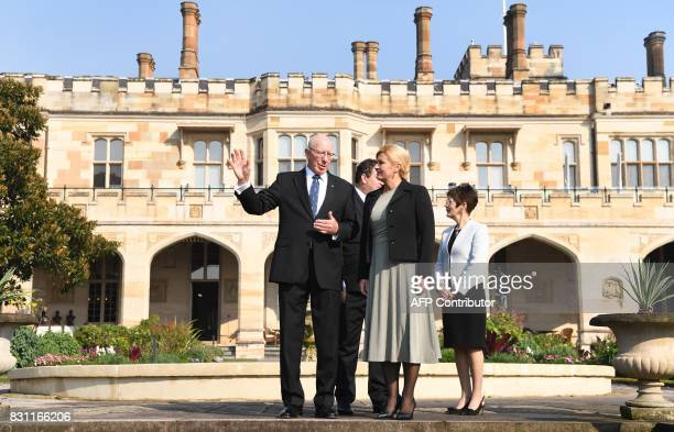 The Governor of New South Wales David Hurley speaks with Croatia's President Kolinda GrabarKitarovic during a walk in the gardens at Government House...