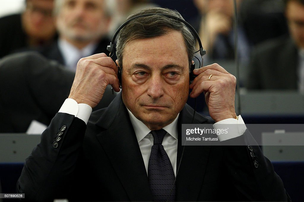 The governor of the European central Bank, or ECB Mario Draghi adjusts his earphones in the plenary room in the European Parliament ahead of the debate on the ECB report for 2014 on February 1, 2016 in Strasbourg, France. During the last press conference in Frankfurt, Draghi indicated that the bank may review its course of action in March.