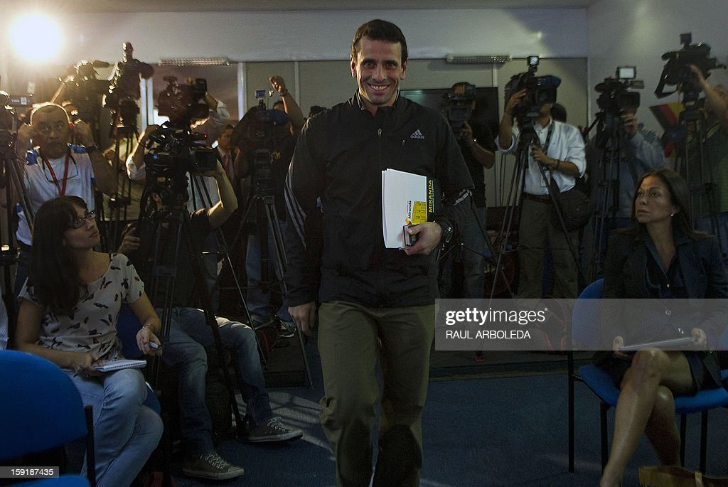 The governor of Venezuelan state of Miranda, Henrique Capriles, arrives for a press conference in Caracas on January 9, 2013. A constitutional fight over cancer-stricken President Hugo Chavez's status intensified Tuesday with the government planning a massive show of support in the streets on the day he is supposed to be sworn in to a new term. The call for a rally Thursday outside the Miraflores presidential palace comes amid a stormy debate over whether Chavez and his current government can remain in office if he is too sick to take the oath of office. Chavez, who underwent his fourth round of cancer surgery in Havana nearly a month ago, is suffering from a severe pulmonary infection that has resulted in a respiratory insufficiency. AFP PHOTO/Raul ARBOLEDA