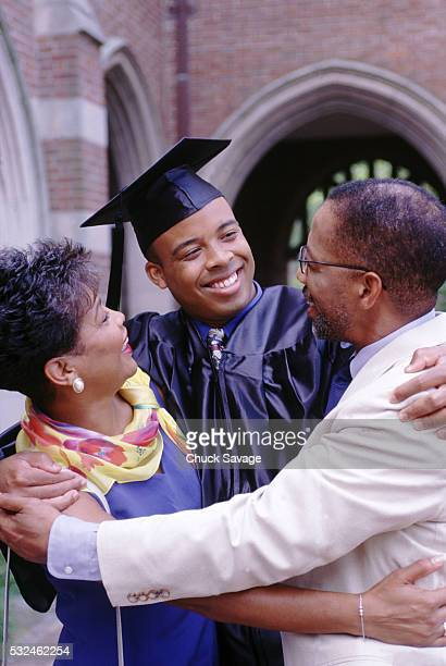 The graduate with his parents