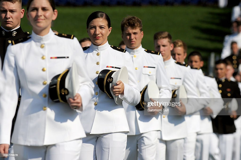 The graduating midshipmen march onto the field as the United State Naval Academy holds its 2016 Commissioning Ceremony on Friday, May 27, 2016, at Navy-Marine Corps Memorial Stadium in Annapolis, Md.