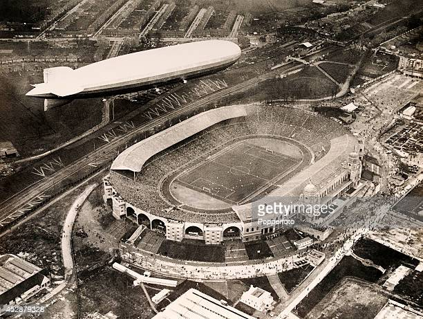 The Graf Zeppelin flying over Wembley Stadium in London during the FA Cup Final between Arsenal and Huddersfield Town on 26th April 1930 Arsenal won...