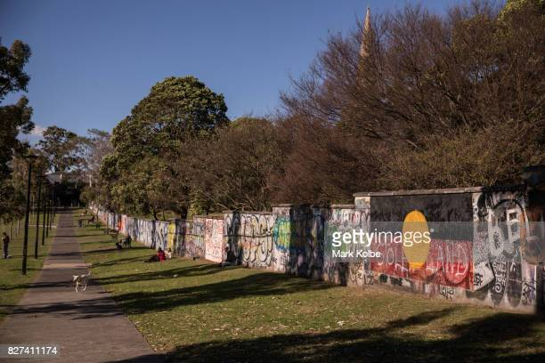 The graffiti covered boundary fence of St Stephen's Anglican Church is seen in Camperdown Memorial Rest Park on August 7 2017 in Newtown Australia...