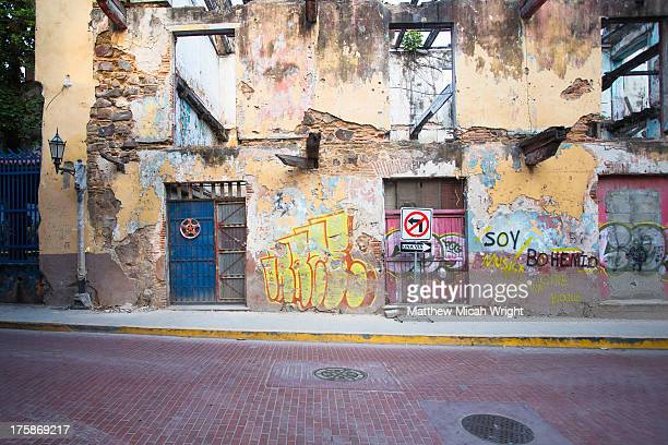 The graffiti lined buildings of old city at night