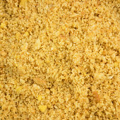 The close up of graham cracker crust mix with melted butter for pie or tart baking.