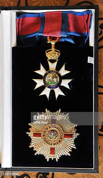 The Grand Cross of the Order of St Michael and St George which was granted to the GovernorGeneral of Papua New Guinea Michael Ogio by Queen Elizabeth...
