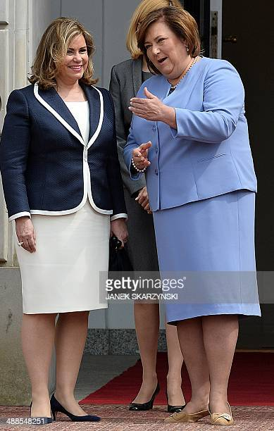 The Grand Duchess of Luxembourg Maria Teresa talks with Poland's First Lady Anna Komorowska during a welcoming ceremony at the court of presidential...