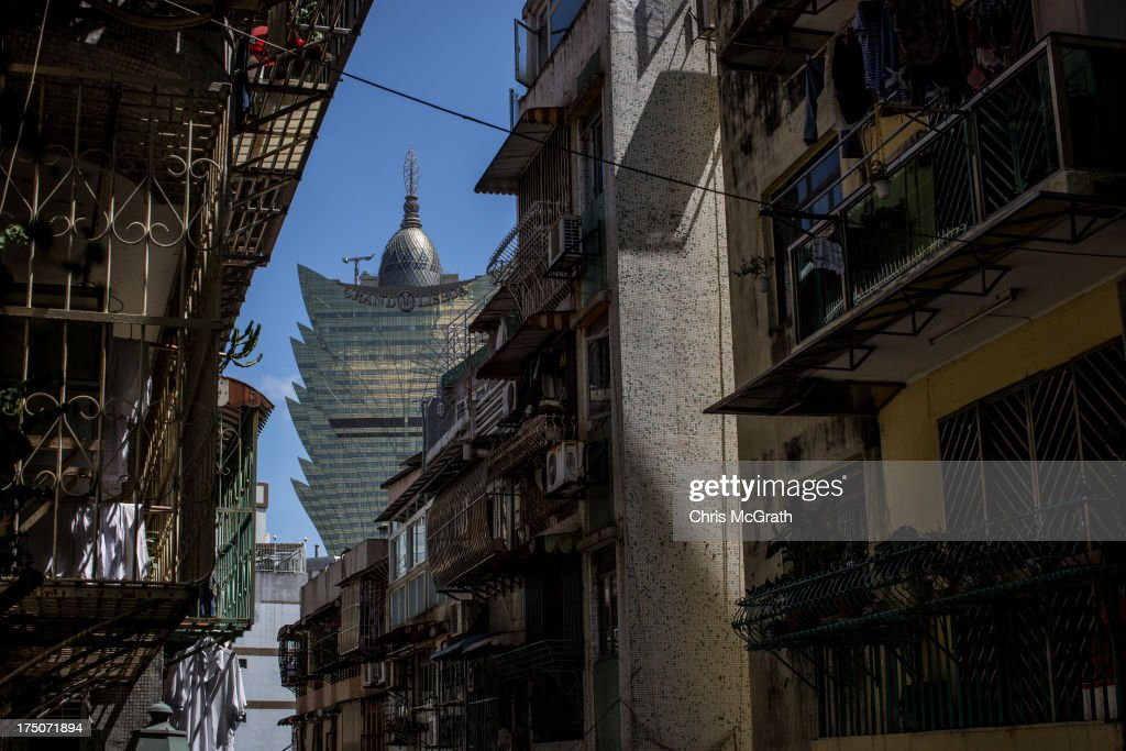 The Grand Lisboa casino and hotel is seen through residential buildings on July 29, 2013 in Macau, Macau. Macau, the only place in China with legalized casino gambling is booming. Gambling has been legal in Macau for more than 150 years but has seen a rapid transformation over the last decade from the small time gambling clubs, gangs and prostitution of the 1990s, to becoming the worlds gambling mecca. Last year, Macau generated $38 billion in casino revenue, six times more than Las Vegas, Nevada. Situated just one hour from mainland China and Hong Kong, Macau also known as 'The Oriental Las Vegas ' received 14.1million visitors for the first six months of this year, in the most recent Statistics and Census Bureau report, with close to 90% of visitors being from mainland China, Taiwan and Hong Kong. Although the gambling industry has improved general living standards across Macau, it is not without it's downside. With the influx of big money also comes, higher living costs, with some residents saying issues such as transportation, health care and social welfare have largely been ignored. Property prices have increased dramatically, forcing many small and mid-sized businesses into bankruptcy and pushing some residents to share accommodation or move away completely.