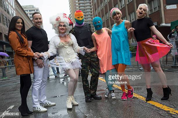 TORONTO JUNE 28 2015 The Grand Marshalls for this year's parade From left Celina Jaitly David Furnish Cyndi Lauper Pussy Riot and Youth Ambassador...