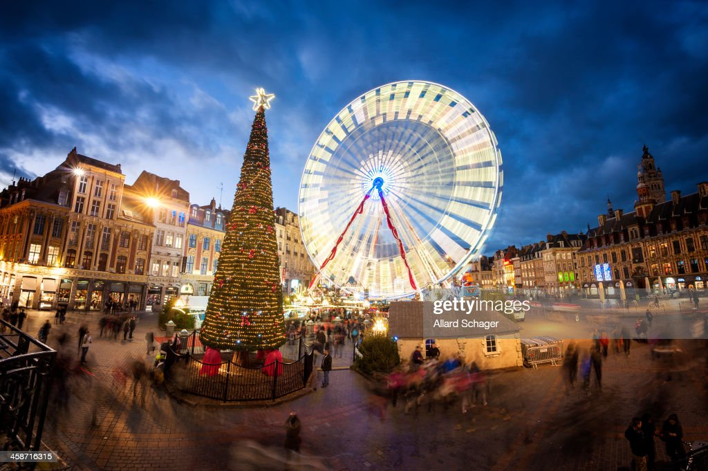 CONTENT] The Grand Place in Lille, France, where in december a giant christmas tree and Ferris Wheel are erected. Long exposure.