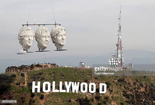 The Grand Tour the giant stone heads of British motoring presenters Jeremy Clarkson James May and Richard Hammond make a dramatic appearance in Los...