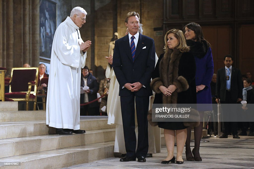 The Grand-Duke Henri of Luxembourg (L), his wife Grand-Duchess Maria Teresa (C), and their daughter Princess Alexandra (R) attend a mass at Paris' Notre-Dame de Paris Cathedral during which the church's nine new bells have been blessed on February 2, 2013 in Paris.