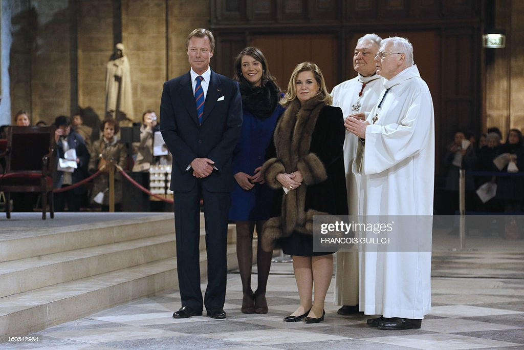 The Grand-Duke Henri of Luxembourg (L), his wife Grand-Duchess Maria Teresa (R), and their daughter Princess Alexandra (C) attend a mass at Paris' Notre-Dame de Paris Cathedral during which the church's nine new bells have been blessed on February 2, 2013 in Paris.
