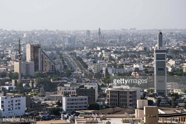 The Grande Mosque de Dakar right and the Central Bank of West African States left stand among residential buildings in Dakar Senegal on Friday July...