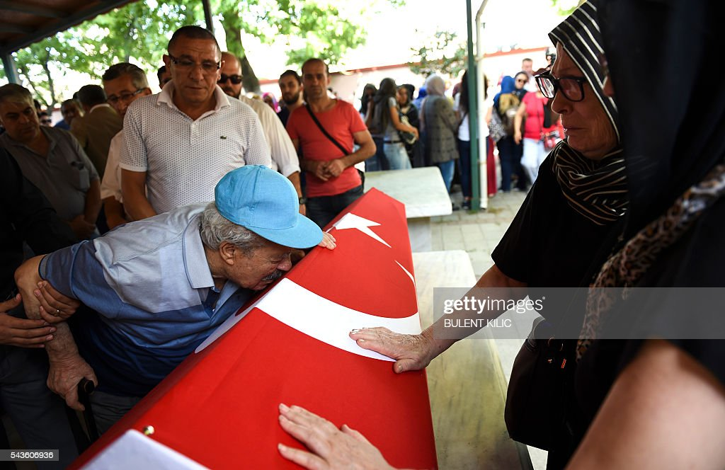 The grandfather of air hostess Gulsen Bahadir killed during last night attacks, kisses the coffin during the funeral in Istanbul, on June 29, 2016, a day after a suicide bombing and gun attack targeted Istanbul's airport, killing at least 36 people. A triple suicide bombing and gun attack that occurred on June 28, 2016 at Istanbul's Ataturk airport has killed at least 36 people, including foreigners, with Turkey's prime minister saying early signs pointed to an assault by the Islamic State group. / AFP / BULENT