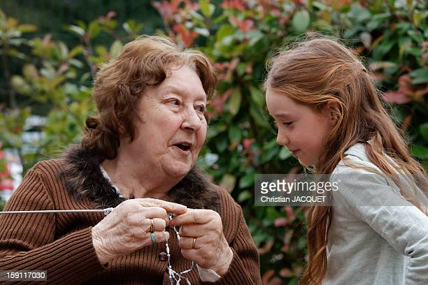 The grandmother and granddaughter knitting