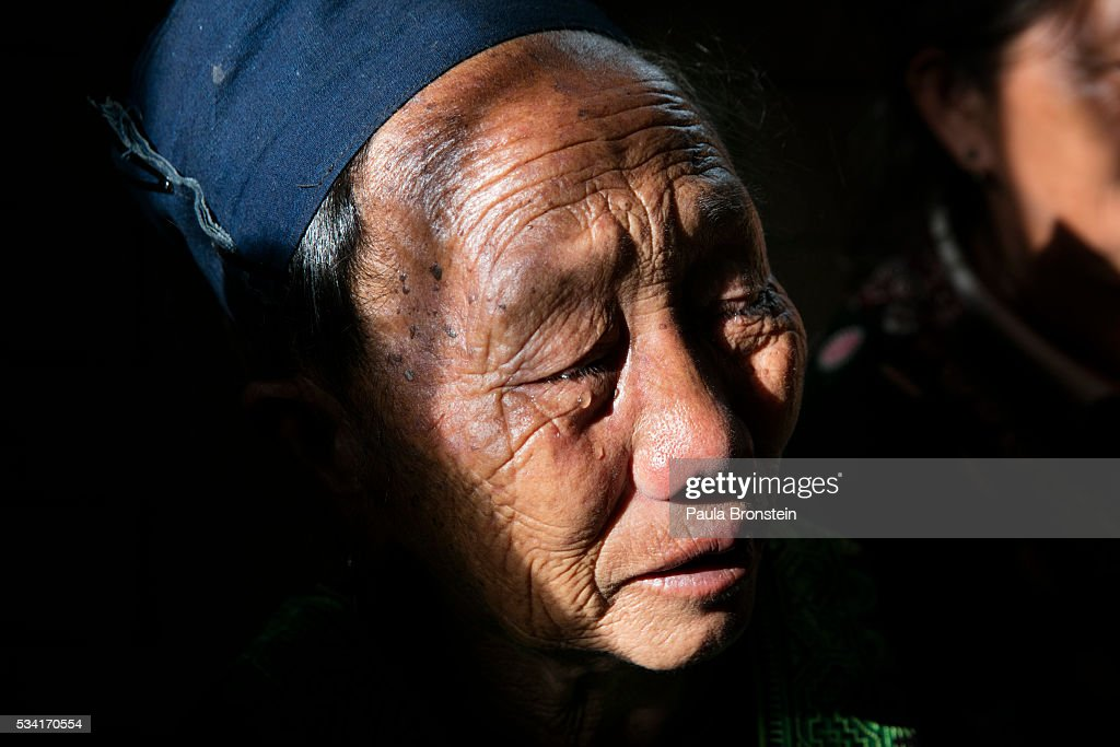 The grandmother of Kanjanaporn (May) Lasasong age 8, grieves at her funeral in Mae Wang, Chiang Mai province May 25, 2016. A tragic fire broke out on Sunday night killing at least 17 girls at the Pitakkiat Wittaya school, home to pupils from impoverished local hill tribes in the region, they were aged between 5 to 13. Based on reports, many of the 38 students were asleep when the fire swept through the elementary school in Chiang Rai Province and investigations are still being carried out to find the cause of the fire.