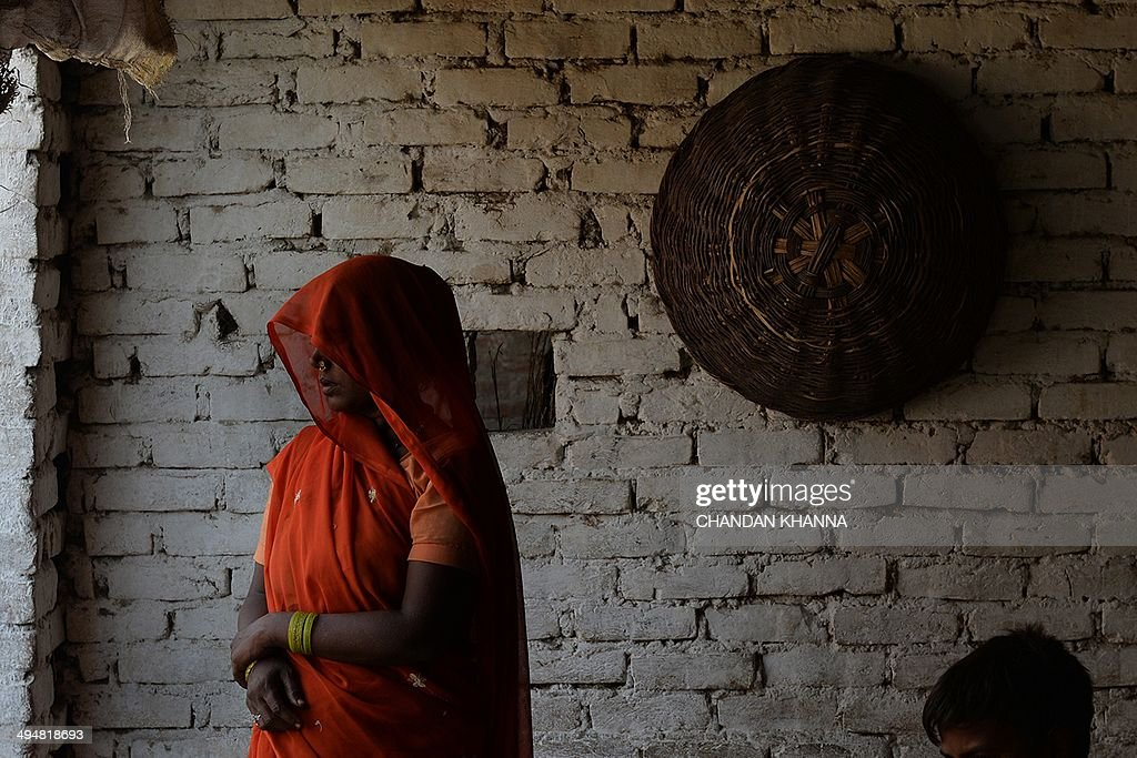 The grandmother of the gangrape victims looks on at a residence in Katra Shahadatgunj in Badaun India's Uttar Pradesh state on May 31 2014 Two minor...