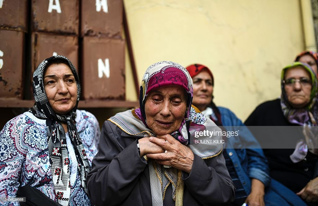 The grandmother of the victim cries as people gather for the funeral of Turkish teacher Huseyin Tunc in Istanbul on June 30, 2016 two days after the triple suicide bombing and gun attack occurred at Istanbul's Ataturk airport. The death toll from the triple suicide bombing and gun attack that occurred on June 28, 2016 at Istanbul's Ataturk airport has risen to 43 including 19 foreigners. The government has pointed the finger of blame at the Islamic State group and Turkish police rounded up 13 suspected IS jihadists in raids at 16 different locations across Istanbul on June 30. / AFP / BULENT