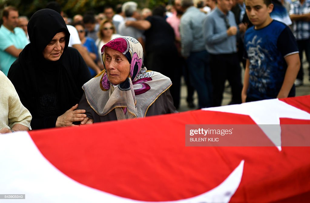 The grandmother of the victim cries in front of the coffin as people gather for the funeral of Turkish teacher Huseyin Tunc in Istanbul on June 30, 2016 two days after the triple suicide bombing and gun attack occurred at Istanbul's Ataturk airport. The death toll from the triple suicide bombing and gun attack that occurred on June 28, 2016 at Istanbul's Ataturk airport has risen to 43 including 19 foreigners. The government has pointed the finger of blame at the Islamic State group and Turkish police rounded up 13 suspected IS jihadists in raids at 16 different locations across Istanbul on June 30. / AFP / BULENT