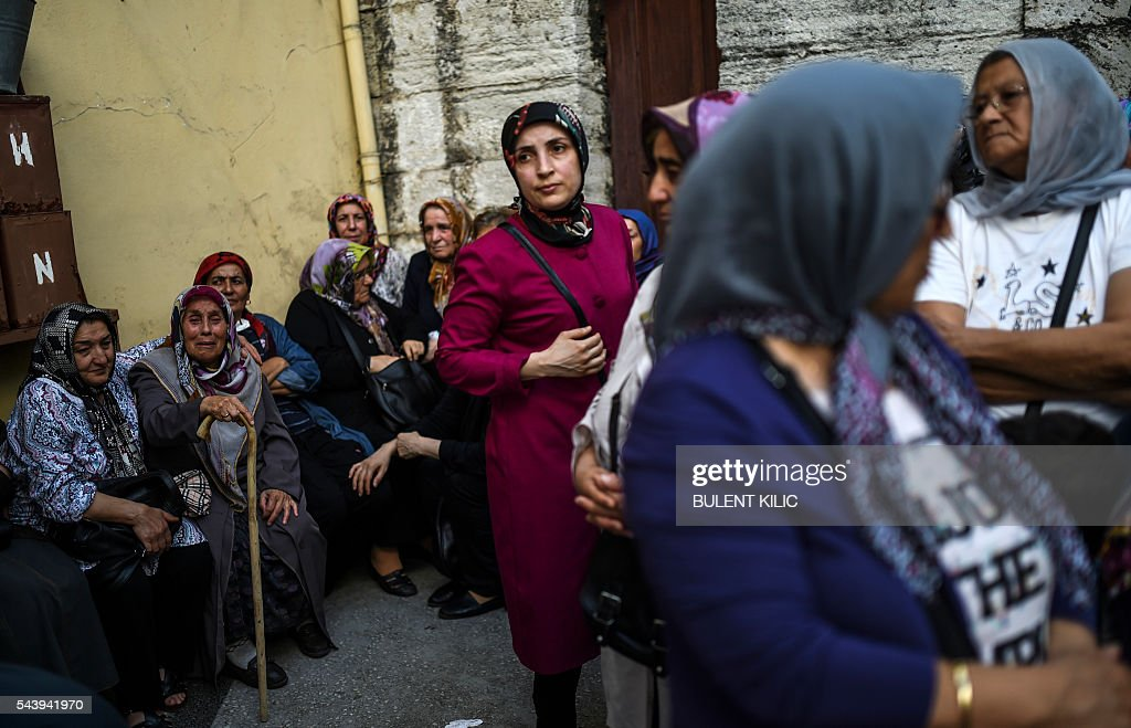 The grandmother of the victim (2nd L) reacts as people gather for the funeral of Turkish teacher Huseyin Tunc in Istanbul on June 30, 2016 two days after the triple suicide bombing and gun attack occurred at Istanbul's Ataturk airport. Turkey on June 30 detained 13 suspected Islamic State jihadists over the deadly Istanbul airport attack, as chilling details emerged of how suicide bombers launched their assault. The death toll from the triple suicide bombing and gun attack that occurred on June 28, 2016 at Istanbul's Ataturk airport has risen to 44 including 19 foreigners. / AFP / BULENT
