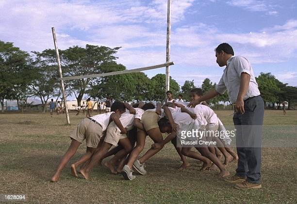 The grass roots of rugby as epitomised by children practising a scrum down in Fiji Mandatory Credit Russell Cheyne/Allsport
