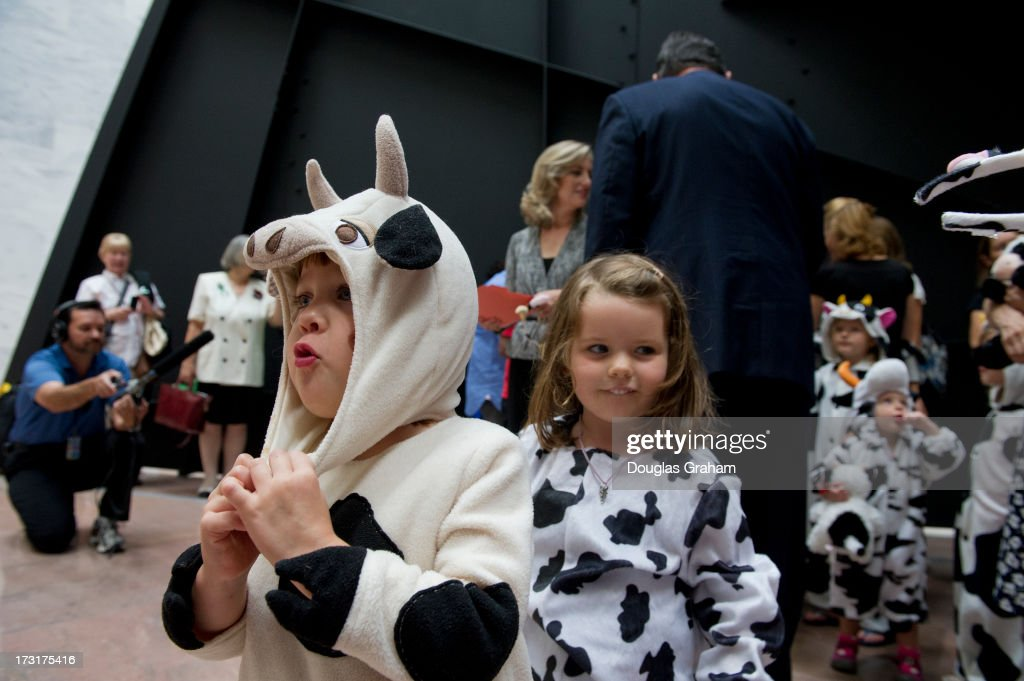 The grassroots movement Momsrising.org staged an event in the Hart Senate Office Building on July 9, 2013 with children dressed in cow suits with the message, 'Dont Be Cowed by the Gun Lobby.'