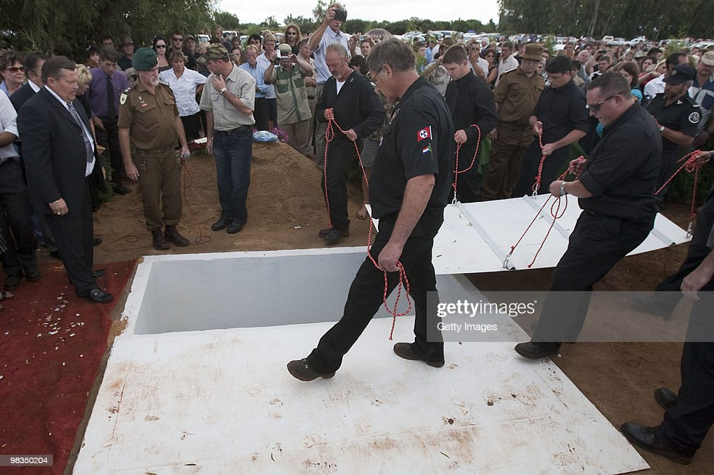 The grave is covered during the funeral of Afrikaner Resistance Movement (AWB) slain leader Eugene Terre'Blanche on April 9, 2010 in Ventersdorp, South Africa. Some 3,000 people attended the funeral of the white supremacist who was murdered last Saturday at his farm. Two of Terrblanche's employees have been charged with his murder.
