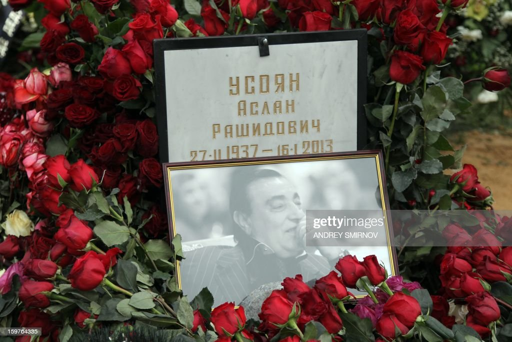 The grave of Aslan Usoyanis covered in flowers at Hovanskoye cemetery in Moscow on January 20, 2013.Russian crime boss Aslan Usoyan was buried in a tightly controlled ceremony in Moscow on Sunday, after efforts to fly his body to his hometown in Georgia fell through. Usoyan, 75, was the head of a gang that is reportedly the most powerful in the former Soviet Union.
