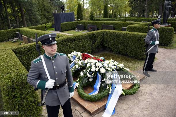 The grave of Finland's former President Mauno Koivisto is pictured during the burial ceremony at the Hietaniemi cemetary in Helsinki on May 25 2017 /...
