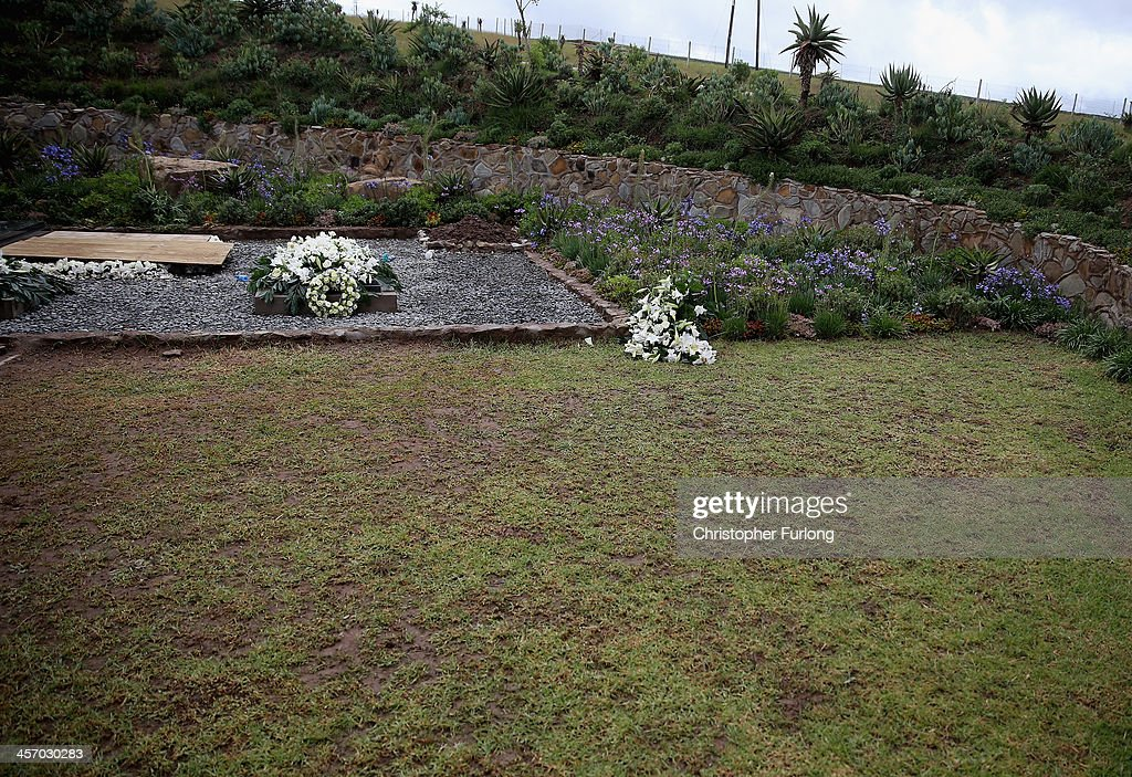 The grave of former South African President Nelson Mandela is covered with flowers in is home village of Qunu on December 16, 2013 in Qunu, South Africa. Mr. Mandela passed away on the evening of December 5, 2013 at his home in Houghton at the age of 95. Mandela became South Africa's first black president in 1994 after spending 27 years in jail for his activism against apartheid in a racially-divided South Africa.