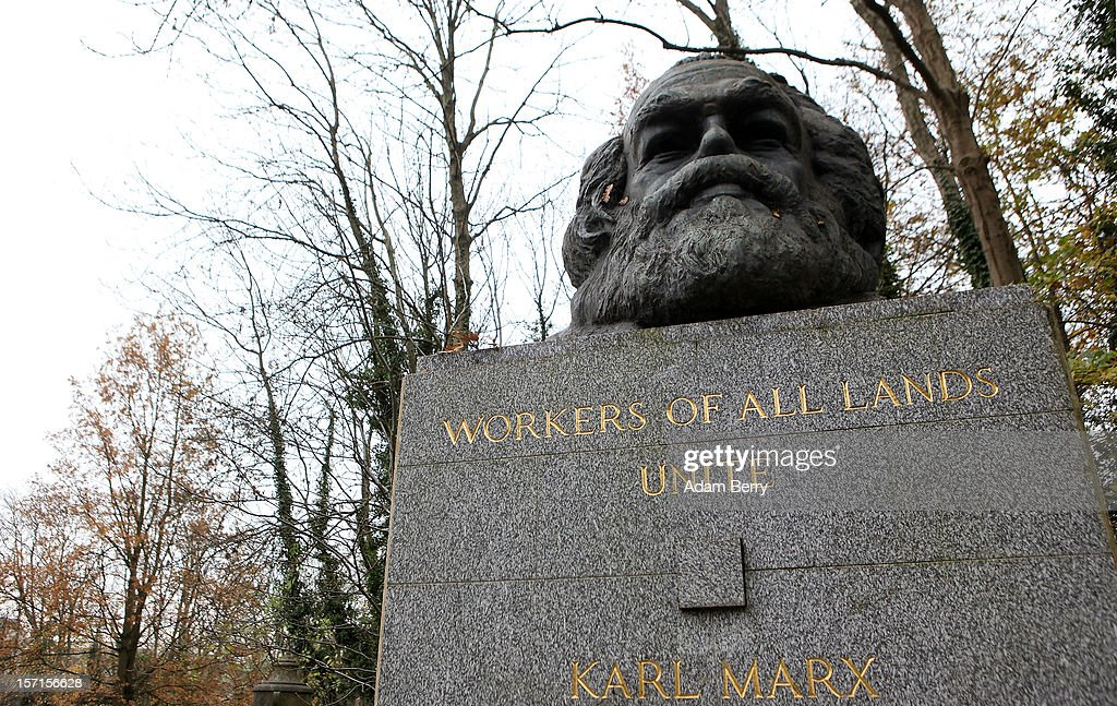 The grave of German philosopher and economic theorist Karl Heinrich Marx, remembered as the founder of modern Socialism and Communism, stands on November 19, 2012 in Highgate Cemetery in London, England. From a Marxist perspective, economic crises are inevitable, and Marx attempted to explain financial turmoil in terms now referred to as 'the real economy.'