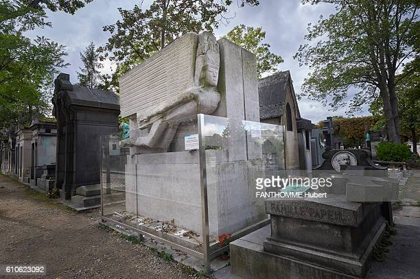 The grave of Oscar Wilde at the cemetery of the Pere Lachaise in Paris topped with a sculpture of Jacob EPSTEIN called Flying Devil Angel who has...